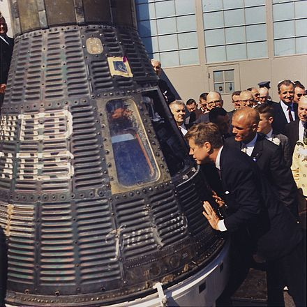 Accomplanied by astronaut John Glenn, Kennedy inspects the Project Mercury capsule Friendship 7, 23 February 1962 JFK inspects Mercury capsule, 23 February 1962.jpg