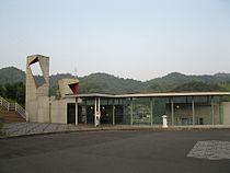 JRShikoku-Kotoku-line-T18-Orange-town-station-entrance-20100803.jpg