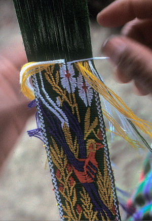 Maya textiles - Detail of hair sash being brocaded on a Jakaltek Maya backstrap loom.