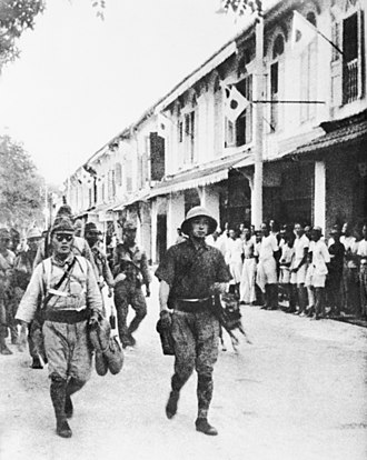 History of Sabah - Japanese troops march through the streets of Labuan on 14 January 1942.