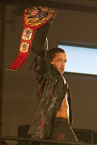 Jay White - White in April 2018 as IWGP United States Heavyweight Champion