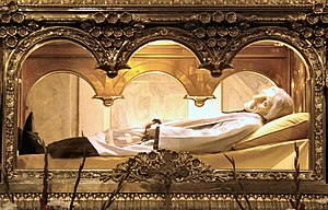 John Vianney - The body of Saint John Mary Vianney, found to be incorrupt by the Catholic Church. The body,  wearing a wax mask, is entombed above the main altar in the Basilica at Ars, France.