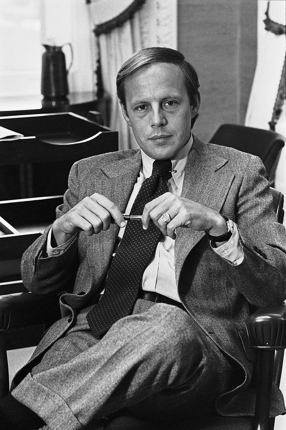 John Dean photo portrait as White House Counsel black and white sitting