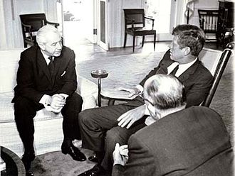 Harold Holt and US President John F. Kennedy in the Oval Office in Washington D.C., 1963. By the 1960s, Australian defence policy had shifted from Britain to the US as key ally. John F. Kennedy and Harold Holt.jpg