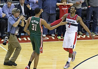 John Henson (basketball) - Henson with the Bucks in March 2013, greeting John Wall of the Washington Wizards