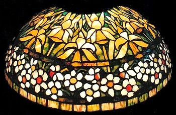 A typical copper foil Tiffany lamp, with a jon...