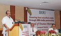 K.V. Thomas delivering the keynote address at a seminar organized by International Rice Research Institute.jpg
