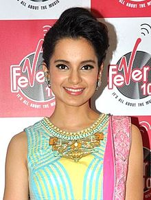 Kangana Ranaut is smiling at the camera