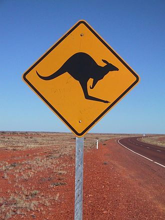 "Roadkill cuisine - A ""kangaroo crossing"" sign on an Australian highway"