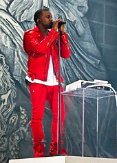 A picture of a man dressed in red singing