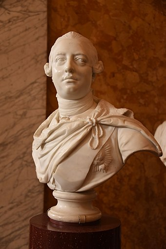 Bust by John van Nost the younger, 1767 King George III of the United Kingdom, by John van Nost the Younger 1767 CE. It is housed in the British Museum, London; lent by the Victoria and Albert Museum.JPG