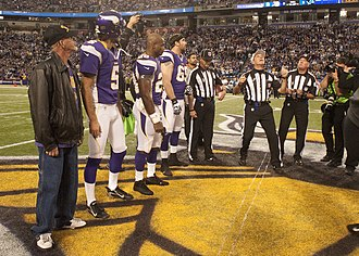 Pete Morelli - Pete Morelli conducts a coin toss with back judge Rob Vernatchi and field judge Jon Lucivansky