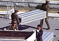 Korean People's Army Soldiers unload nine caskets of remains which they will repatriate during a repatriation ceremony at the Panmunjom Joint Security Area on 981106-F-AF179-020.jpg