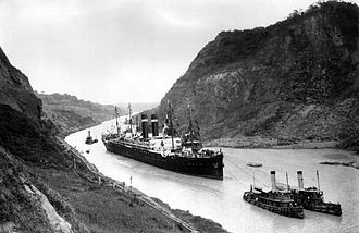 SS Kroonland sails in the Culebra Cut of the Panama Canal on 2 February 1915. Kroonland was the largest passenger ship to transit the canal to that date. Kroonland in Panama Canal, 1915.jpg