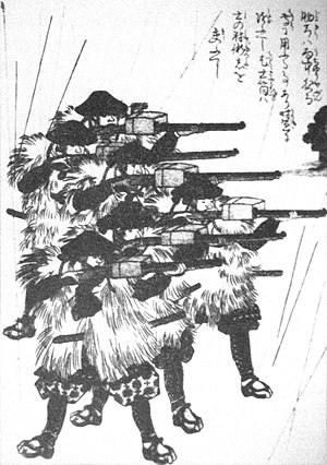 Ashigaru - Edo period print of ashigaru wearing ''mino'' (straw raincoats) in the rain while firing tanegashima (Japanese matchlocks).