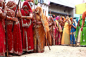 Nanda Baba - Women waiting for Gopis in the streets of Nandgaon during Lath mar Holi