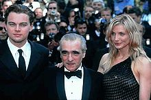 A photograph Leonardo DiCaprio with Martin Scorsese and Cameron Diaz (from left to right) surrounded by the paparazzi