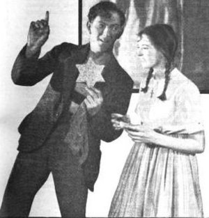 "Carousel (musical) - ""A star—please, my dear—I must do something good.""  Liliom (Joseph Schildkraut) offers Louise (Evelyn Chard) the star he stole; 1921 Theatre Guild production"