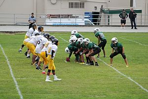 High school football - Offensive line for Mission Secondary School lines up against Defensive line for Hugh Boyd Secondary in JV game played at MSS September 17, 2015. MSS is Located in Mission, British Columbia, Canada.