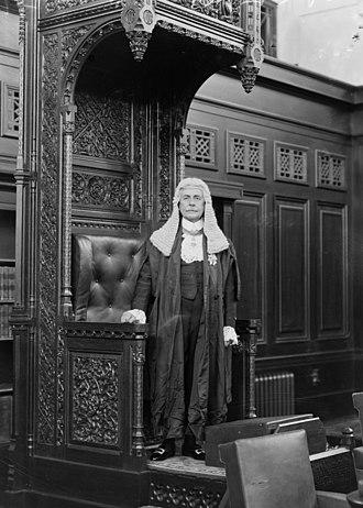 Speaker of the Australian House of Representatives - Littleton Groom (Speaker 1926–1929) standing by the speaker's throne in Old Parliament House, Canberra, in the traditional speaker's garb