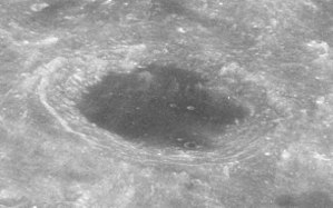 Lomonosov (lunar crater) - Oblique view from Apollo 8 at a high sun angle, demonstrating the crater's dark floor