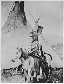 Looking Glass, a Nez Perce' chief, on horseback in front of a tepee, 1877 - NARA - 530914.jpg