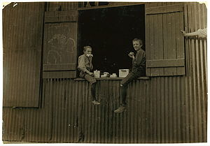 Morgantown, West Virginia - Lunch time for two boys employed at the Economy Glass Works in Morgantown, 1908.  Photo by Lewis Hine.