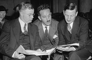 J. Warren Madden - J. Warren Madden (left) goes over testimony with Charles Fahy (right) and Nathan Witt prior to a U.S. Senate Commerce Committee hearing on December 13, 1937.