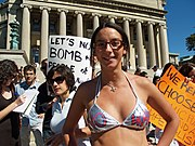 This protester, against a NYC visit by Mahmoud Ahmadinejad, uses a bikini as a message board