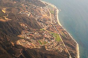 Pepperdine University - An aerial view of the campus from 2014, with the Santa Monica Mountains to the left (east) and the Pacific Ocean to the right (west)