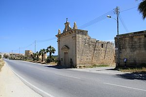 Mamo Tower - The Chapel of St. Cajetan (also built by the Mamo family) with Mamo Tower in the background.