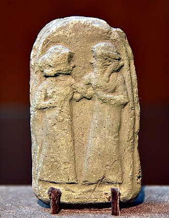 Babylonia - Man and woman, Old-Babylonian fired clay plaque from Southern Mesopotamia, Iraq