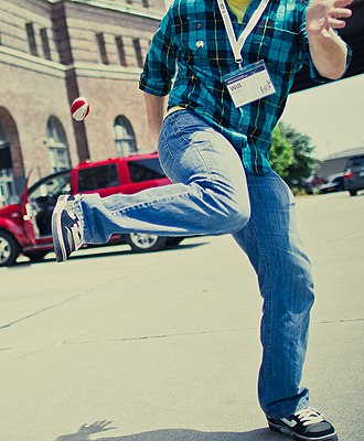 Hacky sack - A man playing with a hacky sack