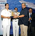 """Manohar Parrikar being felicitated by the Chief of Naval Staff, Admiral R.K. Dhowan, at the Seminar on the """"Innovation and Indigenisation – Sailing towards Self Reliance"""", in New Delhi on July 16, 2015.jpg"""