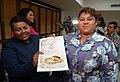 María Alexandra Chávez y Michelle Pamela Avilés muestran documento que confirma su matrimonio - el primero de dos mujeres en Ecuador.jpg