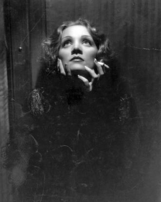Director Josef von Sternberg used butterfly lighting to enhance Marlene Dietrich's features in this iconic shot, from Shanghai Express, Paramount 1932 Marlene Dietrich in Shanghai Express (1932) by Don English.png
