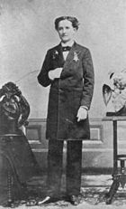 A black and white image of Mary Walker wearing a suit and standing facing the camera with her right hand tucked into her jacket.