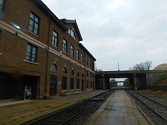 Mattoon station - The Mattoon station platform in April 2016. The depot constructed by the Illinois Central Railroad is present on the left.