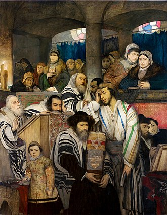 Jewish identity - Ashkenazi Jews praying in the synagogue on Yom Kippur, showing traditional Jewish clothing and practice, including tallit, the Torah, and head coverings. (1878 painting by Maurice Gottlieb)
