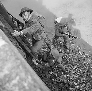 59th (Staffordshire) Infantry Division - Men of the South Staffordshire Regiment of the 59th Division climb up onto a harbour wall during an amphibious exercise in Northern Ireland, 24 April 1942.