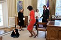 Michelle Obama curtsies with Lynne Silosky.jpg