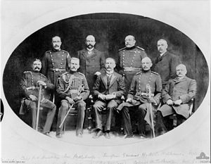 James Whiteside McCay - Group portrait of Commonwealth Headquarters Staff. Identified left to right, back row: Captain P. N. Buckley; Mr S. Petherbridge; Surgeon General W. D. C. Williams; Mr F. Savage. Front row: Colonel H. Le Mesurie; Colonel J. C. Hoad; Lieutenant Colonel J. W. McCay; Colonel W. T. Bridges, Mr J. A. Thompson.