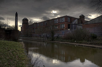 Eccles, Greater Manchester - An Edwardian mill alongside the Bridgewater Canal in Winton. Built in 1906 by the Eccles Spinning and Manufacturing Company, the mill was demolished in 2010