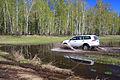 Mitsubishi Pajero Sport runs through spring puddle 05.JPG