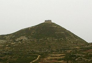 Breast-shaped hill - Mola Murada, one of the mountains of the Moles de Xert, Spain. There is an ancient Iberian archaeological site beneath the hill.