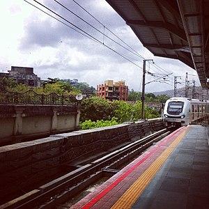 Ghatkopar metro station - Mumbai Metro train arriving at Ghatkopar