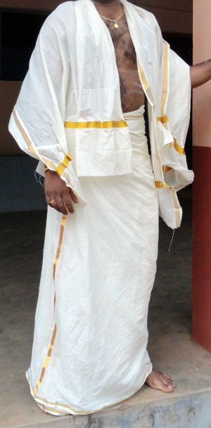 Mundu - A man wearing mundu and melmundu