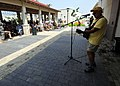 Musician Jimmy Buffet performs for members of Joint Task Force Haiti behind the U.S. Embassy in Port-au-Prince, Haiti, March 3, 2010 100303-N-HX866-006.jpg