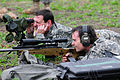 NASCAR driver Jeff Gordon shoots sniper rifle while visiting with National Guard Special Forces.jpg