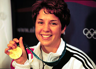 Nancy Johnson (sport shooter) - Johnson with her Olympic gold medal.